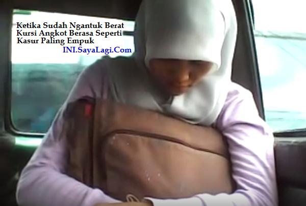 http://image.ibb.co/cBr3Kk/wanita_berjilbab_tidur_di_angkot.png