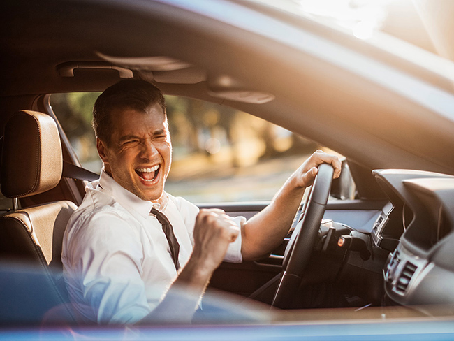Why do many drivers love to sing while driving?