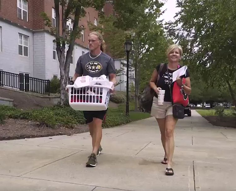 Nate McBride gets help moving on campus to UGA from his mom (Photo from Georgia Football)