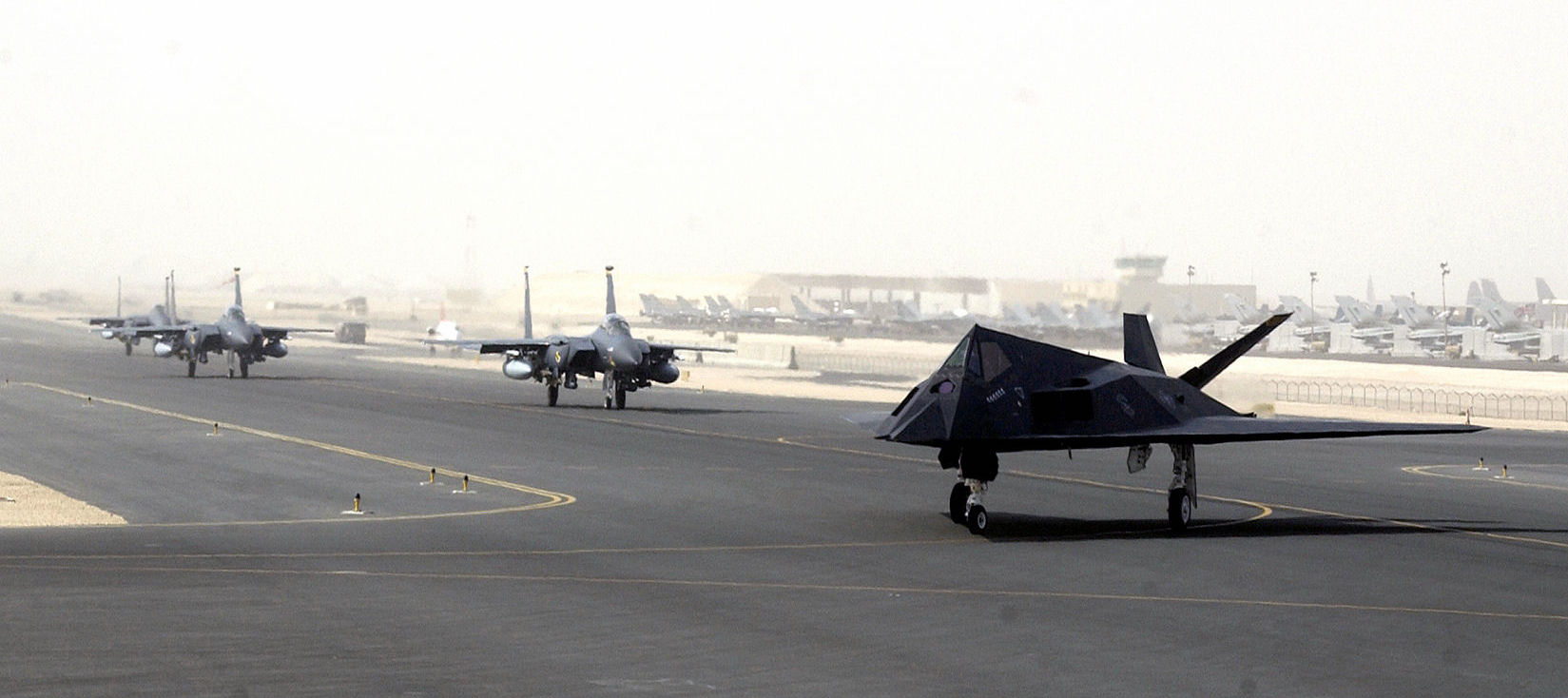 F_15s_and_F_117_taking_off_from_Al_Udeid_Air_Base