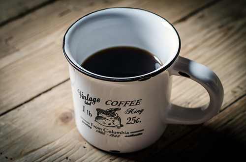 An image of black coffee, commonly a result of advice for writers about sleep patterns.