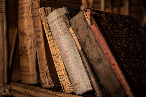 An image of old books one might use in Halloween spells.