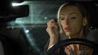 videoblocks_girl_putting_her_make_up_on_in_the_car_at_the_night_fashion_and_style_s3_bfgxiw_thumbnail_small01