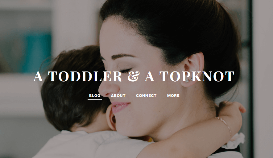 a toddler and a topknot logo