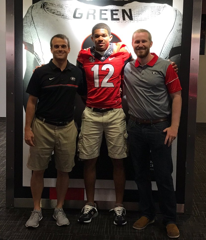 2019 DE Brandon Smith with Georgia coaches Shane Beamer (left) and Glen Schumann (right) (photo from Brandon Smith/Twitter)